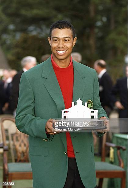 Tigers Woods wears his green jacket and holds his trophy at the Masters Tournament at the Augusta National Golf Course in Augusta Georgia Mandatory...