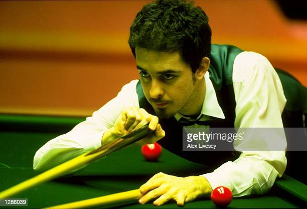 Anthony Hamilton of England uses the rest during the World Snooker Championships at the Crucible Theatre in Sheffield England Mandatory Credit Alex...