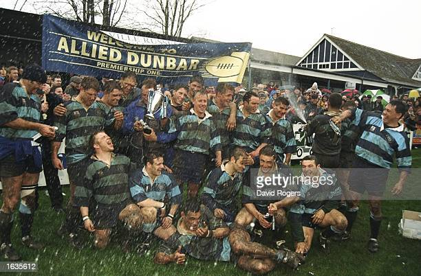 Bedford hold up the Trophy as they win the the Allied Dunbar Premier Two title against Exeter played at the Goldington Road ground The final score...