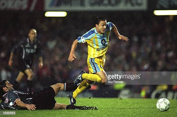 Dennis Wise of Chelsea runs through the Vicenza tackle during the match between Chelsea v Vicenza in the European Cup Winners'' Cup Semifinal played...