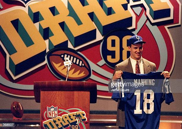 First overall pick Peyton Manning shows off his jersey after being selected by the Indianapolis Colts in the first round of the 1998 NFL Draft at...