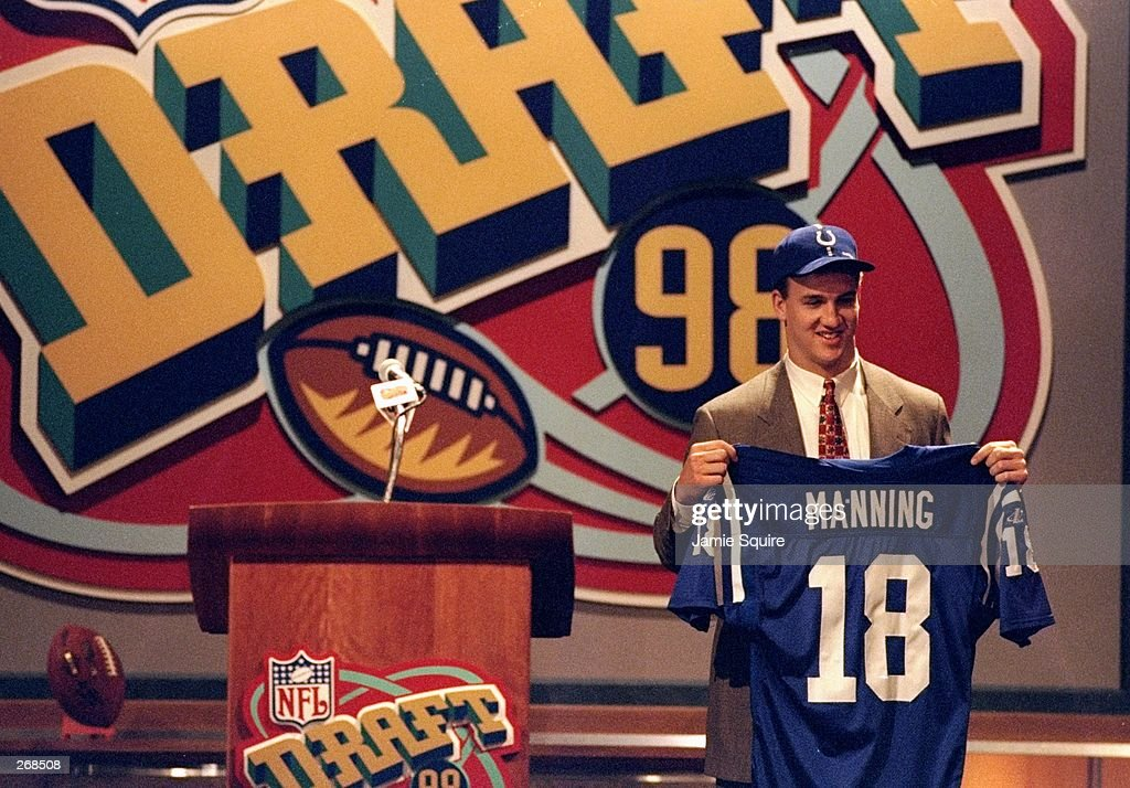 First overall pick Peyton Manning shows off his jersey after being selected by the Indianapolis Colts in the first round of the 1998 NFL Draft at Madison Square Garden in Manhattan, New York. Mandatory Credit: Jamie Squire /Allsport