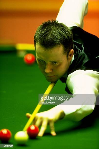 John Higgins of Scotland in action during the World Snooker Championships at the Crucible Theatre in Sheffield England Mandatory Credit Alex Livesey...
