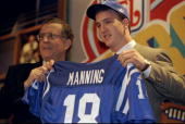 Quarterback Peyton Manning displays an Indianapolis Colts jersey during the NFL draft at Madison Square Garden in New York City New York Mandatory...