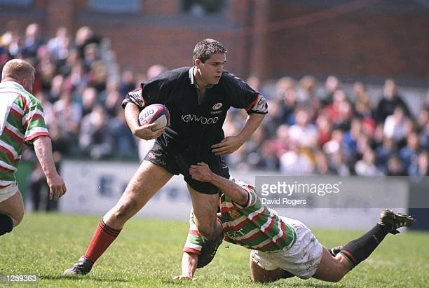 Tony Diprose of Saracens is tackled by Fritz Van Heerden of Leicester during an Allied Dunbar Premiership One match at Welford Road in Leicester...