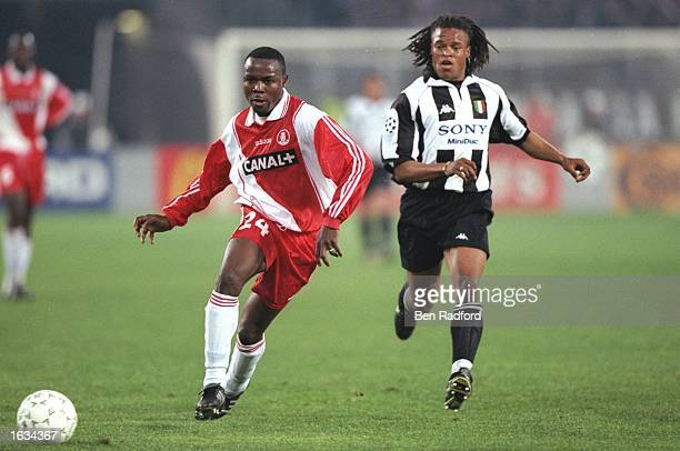 Victor Ikpeba of AS Monaco passes the ball as Edgar Davids of Juventus watches on during the match between Juventus and Monaco in the Champions...