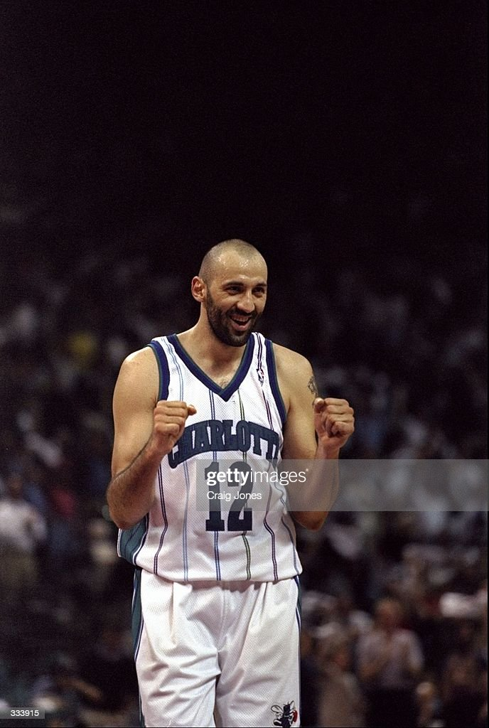 Vlade Divac of the Charlotte Hornets celebrates during a first round Playoff Game against the Atlanta Hawks at the Charlotte Coliseum in Charlotte...