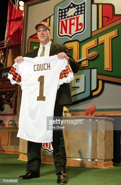 pick Tim Couch of the Cleveland Browns holds up his Browns jersey during the NFL Draft at Madison Square Garden in New York New York Mandatory Credit...
