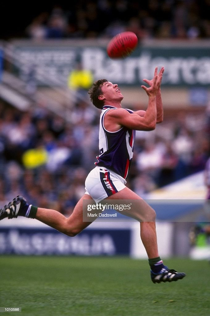 Adrian Fletcher of Fremantle catches on the run, during the 1999 AFL Premiership Round 4 game, where Carlton (121) defeated Fremantle (92), at the Optus Oval, Melbourne, Australia. \ Mandatory Credit: Mark Dadswell /Allsport
