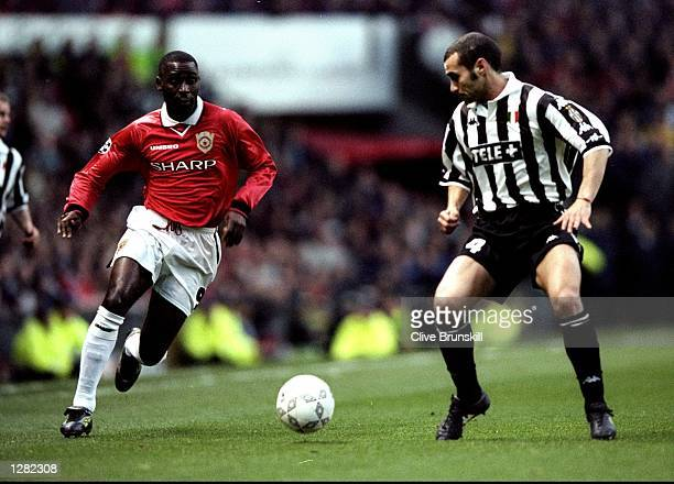 Andy Cole of Manchester United takes on Paolo Montero of Juventus in the UEFA Champions League semifinal first leg match at Old Trafford in...