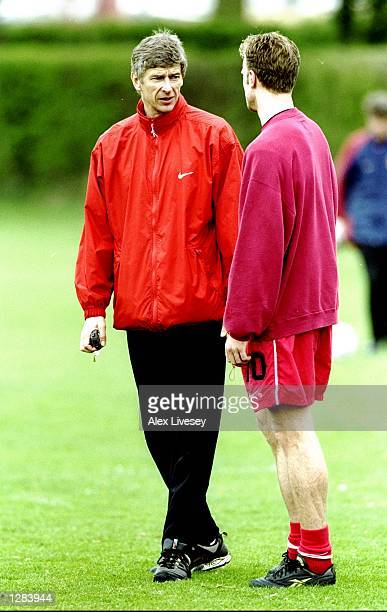 Arsenal manager Arsene Wenger talks tactics with Dennis Bergkamp during training for their FA Cup semifinal at the Colney Ground in London Mandatory...