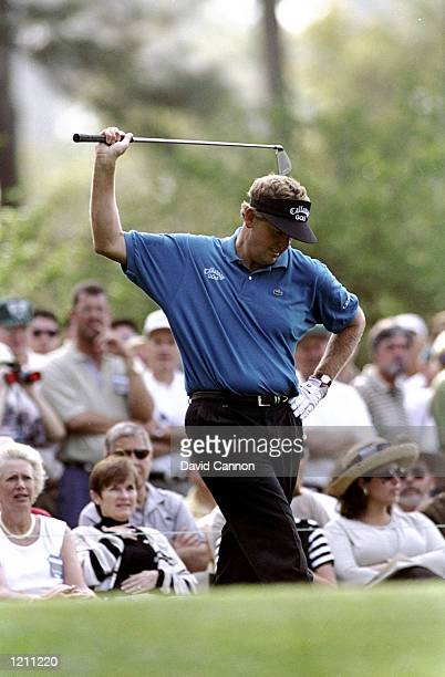 Colin Montgomerie of Scotland lifts his club in anger after playing a bad shot during the 1999 US Masters at the Augusta National GC in Augusta...