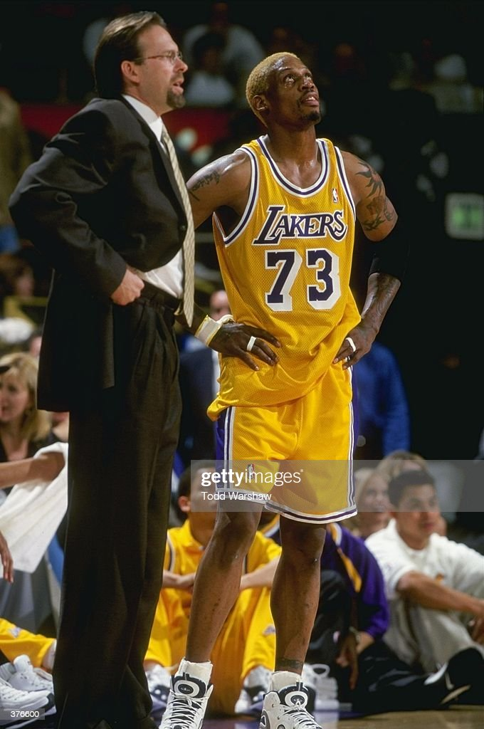 50c2f0200b3 ... Adidas StadiumStyle.com Dennis Rodman 73 of the Los Angeles Lakers  watches the clock as he stands with ...