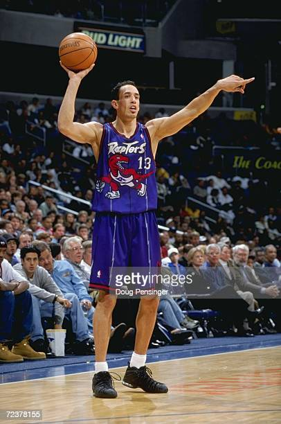 Doug Christie of the Toronto Raptors points as he's ready to pass the ball during the game against the Washington Wizards at the MCI Center in...