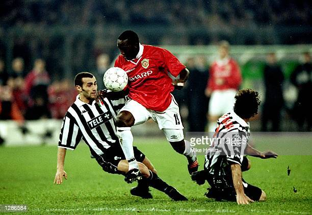 Dwight Yorke of Manchester United beats Paolo Montero and Ciro Ferrara of Juventus in the UEFA Champions League semifinal second leg match at the...
