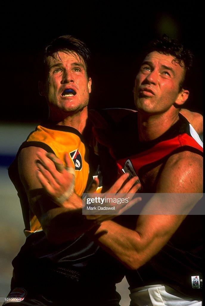 Jason Ball of the West Coast Eagles holds off Steve Alessio of the Essendon Bombers during the 1999 AFL Premiership Round 4 match, where the West Coast (97) defeated Essendon (23) at the Subiaco Oval, Perth, Australia. \ MandatoryCredit: Mark Dadswell /Allsport