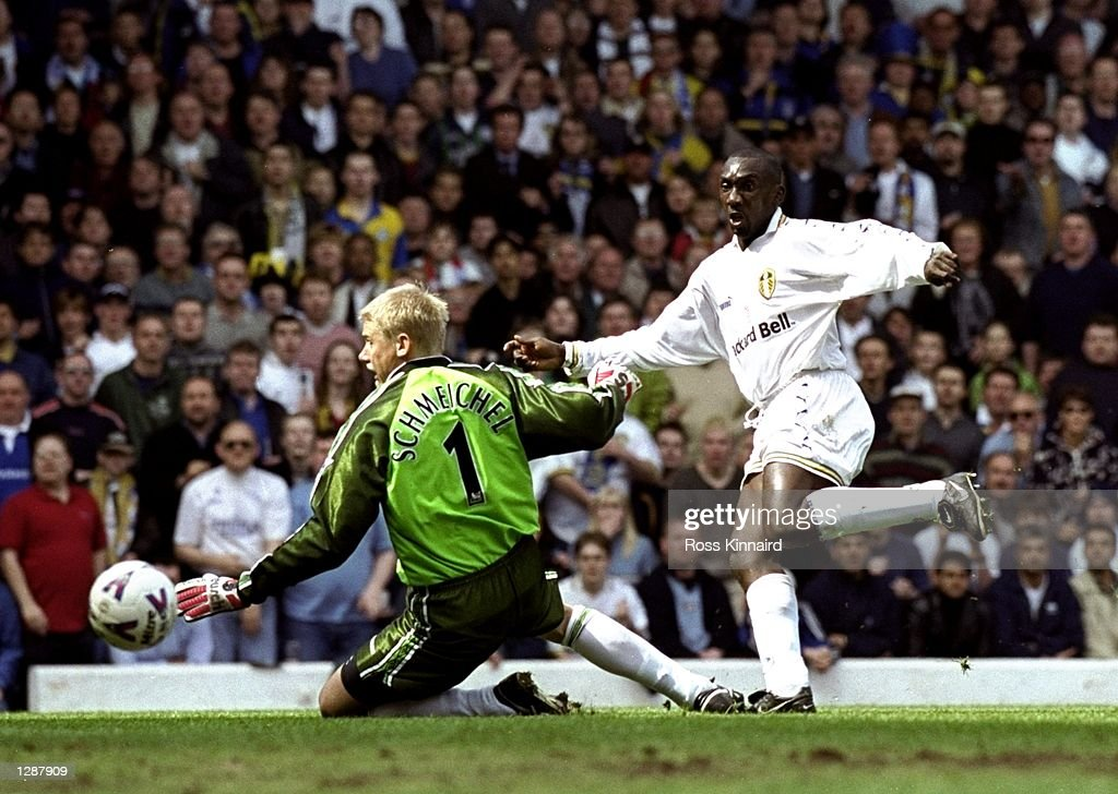 Jimmy Floyd Hasselbaink of Leeds United beats Peter Schmeichel in the Manchester United goal to score during the FA Carling Premiership game between Leeds United v Manchester United at Elland Road in Leeds, England. The game ended in a 1-1draw. \ Mandatory Credit: Ross Kinnaird /Allsport