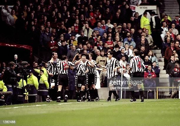 Juventus celebrate Antonio Conte's goal against Manchester United in the UEFA Champions League semifinal first leg match at Old Trafford in...