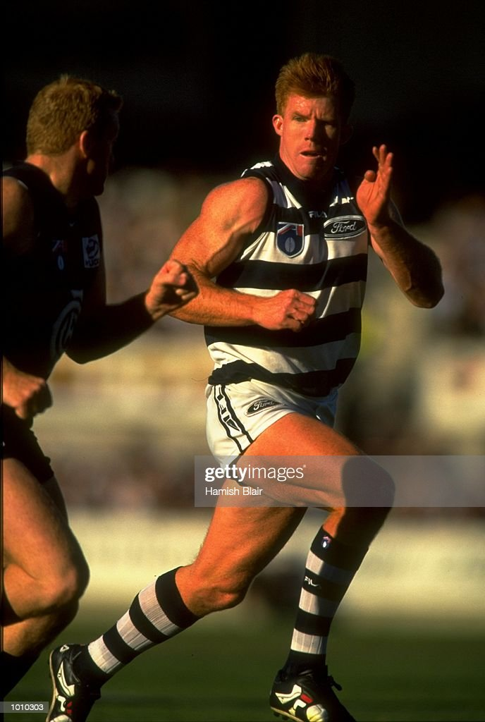Lance Whitnall of the Carlton Blues shadows the run of Geelong's Tim McGrath, during the AFL Premiership Round 5 match at the Optus Oval, Melbourne, Australia. The Geelong Cats (115) defeated the Carlton Blues (65). \ Mandatory Credit: Hamish Blair /Allsport