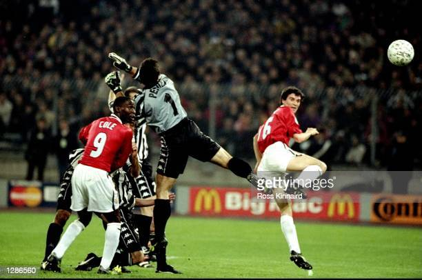 Manchester United captain Roy Keane gets infront of Juventus keeper Angelo Peruzzi to head home during the UEFA Champions League semifinal second leg...