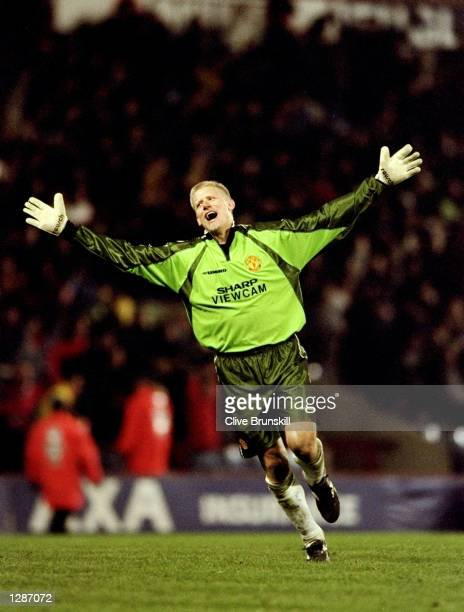 Manchester United keeper Peter Schmeichel celebrates a goal in the FA Cup semifinal replay against Arsenal at Villa Park in Birmingham England...
