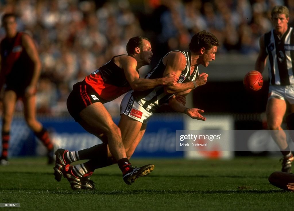 Mark Fraser of the Essendon Bombers tackles Collingwood Magpies'' Rupert Betheras during the AFL Premiership Round 5 match at the MCG, Melbourne, Australia. The Anzac Day game finished with Essendon (108) defeating Collingwood (100). \ Mandatory Credit: Mark Dadswell /Allsport