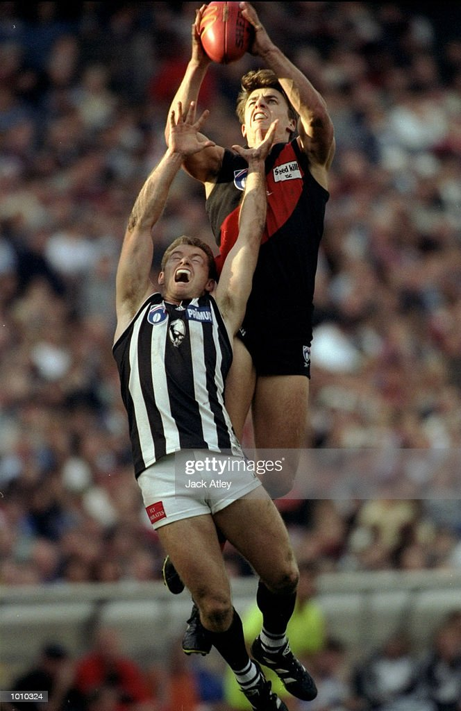 Matthew Lloyd of the Essendon Bombers takes the mark over Collingwood Magpies'' Paul Williams during the AFL Premiership Round 5 match at the MCG, Melbourne, Australia. The Anzac Day game finished with Essendon (108) defeating Collingwood (100). \ Mandatory Credit: Jack Atley /Allsport