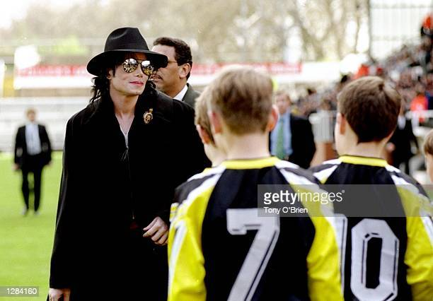 Michael Jackson meets the fulham ball boys before the match between Fulham v Wigan Athletic in the Nationwide 2nd Division Craven Cottage London...