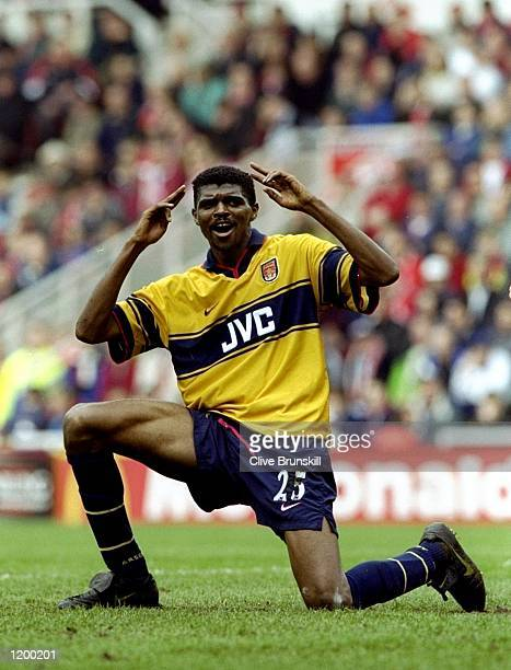 Nwankwo Kanu of Arsenal celebrates the first of his two goals against Middlesbrough in the FA Carling Premiership match at the Riverside Stadium in...