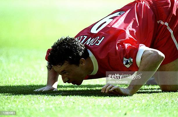 Robbie Fowler of Liverpool mimicks cocaine snorting to celebrate his first goal against Everton in the FA Carling Premiership match at Anfield in...