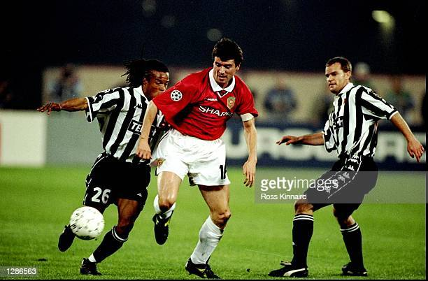 Roy Keane of Manchester United gets past Edgar Davids and Gianluca Pessotto of Juventus in the UEFA Champions League semifinal second leg match at...