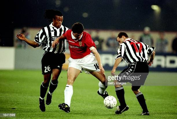 Roy Keane of Manchester United takes on Gianluca Pessotto and Edgar Davids of Juventus during the UEFA Champions League semifinal second leg match at...