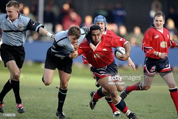Salesi Finau of Llanelli hands off Cardiff's Craig Morgan during the SWALEC Cup semifinal between Llanelli and Cardiff played at Bridgend Wales...