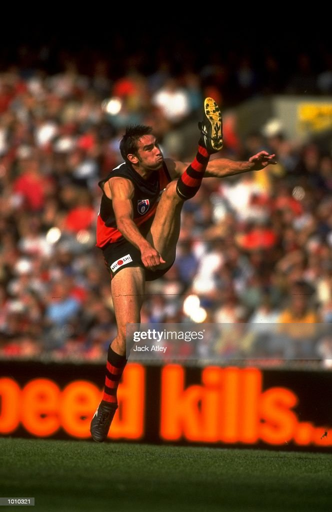 Scott Lucas of the Essendon Bombers launches a high bomb during the AFL Premiership Round 5 match against the Collingwood Magpies at the MCG, Melbourne, Australia. The Anzac Day game finished with Essendon (108) defeating Collingwood (100).\ Mandatory Credit: Jack Atley /Allsport