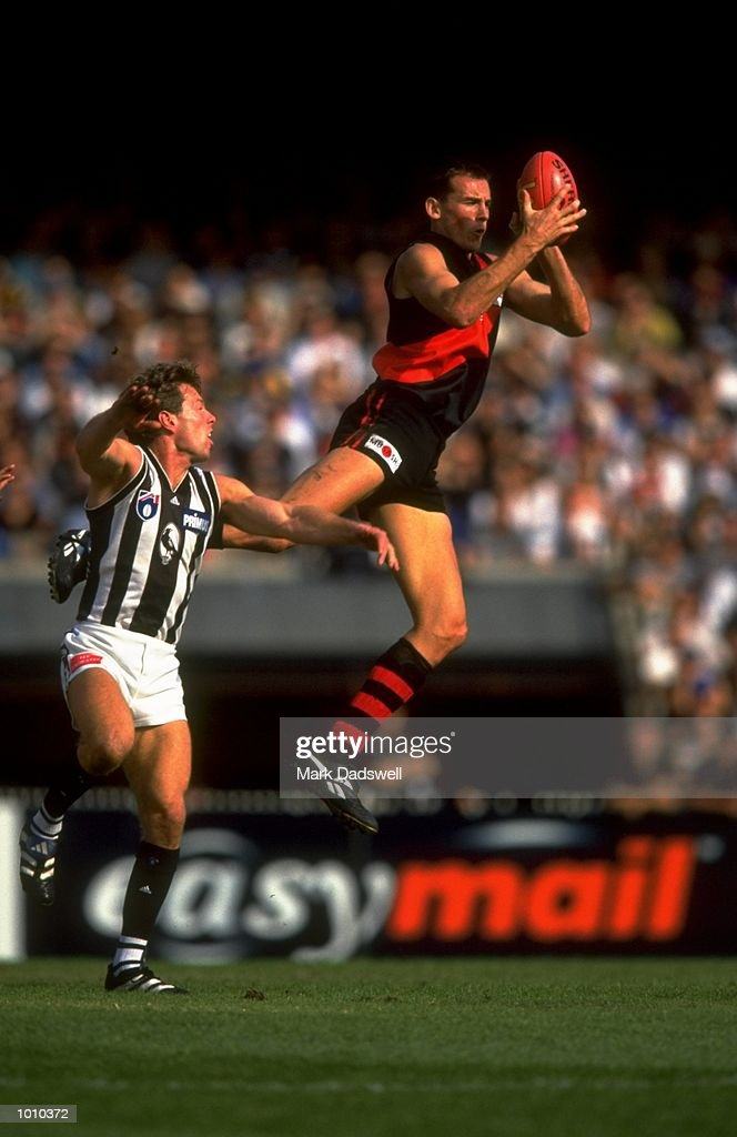 Simon Eastaugh of the Essendon Bombers comes off second best in this battle with Collingwood Magpie Gavin Brown, during the AFL Premiership Round 5 match at the MCG, Melbourne, Australia. The Anzac Day game finished with Essendon (108) defeating Collingwood (100). \ Mandatory Credit: Mark Dadswell /Allsport