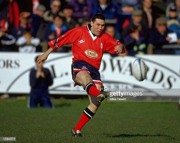 Stephen Jones of Llanelli kicks the ball during the Swalec Cup Semifinal match against Cardiff played in Bridgend Wales The match finished in a...