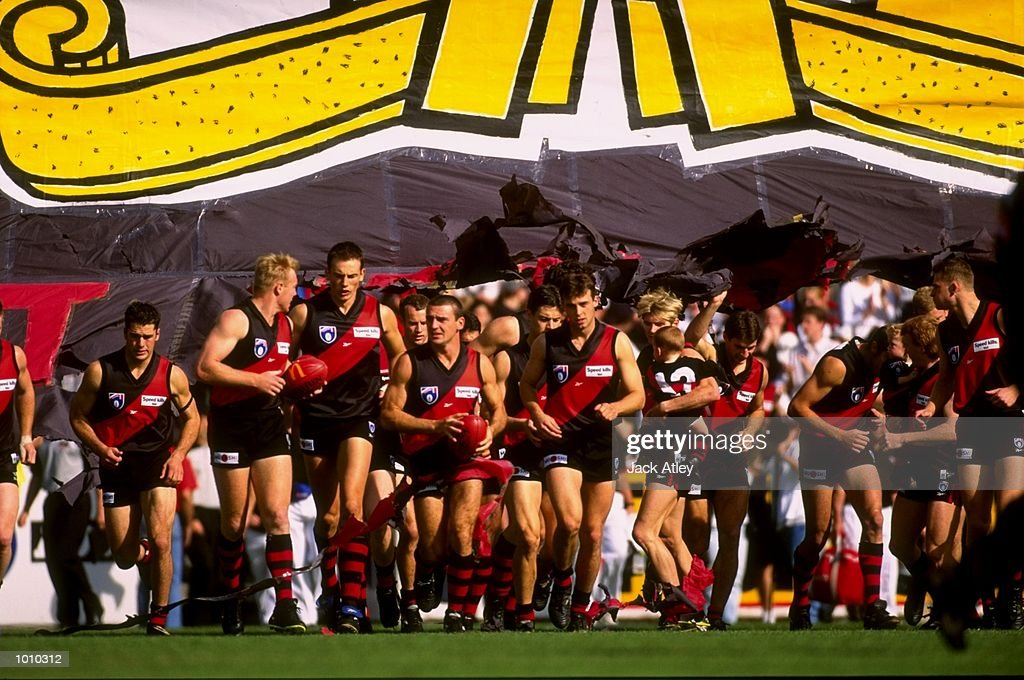 The Essendon Bombers team run onto the pitch for the start of the AFL Premiership Round 5 match against the Collingwood Magpies at the MCG, Melbourne, Australia. The Anzac Day game finished with Essendon (108) defeating Collingwood (100).\ Mandatory Credit: Jack Atley /Allsport