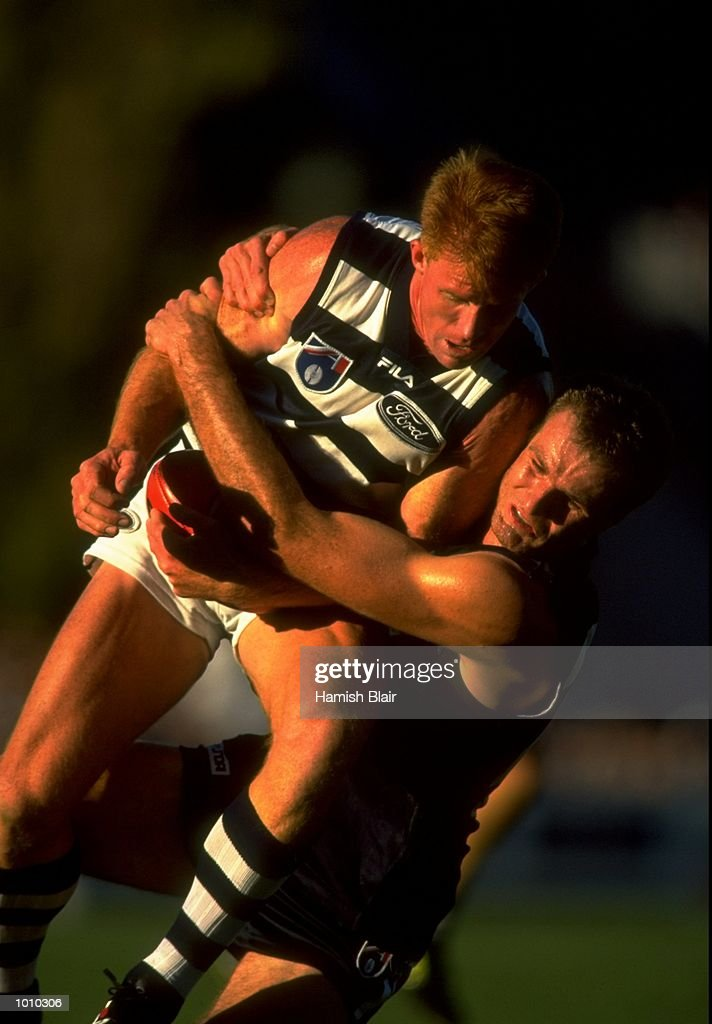 Tim McGrath of the Geelong Cats is tackled by Carlton's Matthew Allan, during the AFL Premiership Round 5 match at the Optus Oval, Melbourne, Australia. The Geelong Cats (115) defeated the Carlton Blues (65). \ Mandatory Credit: Hamish Blair /Allsport