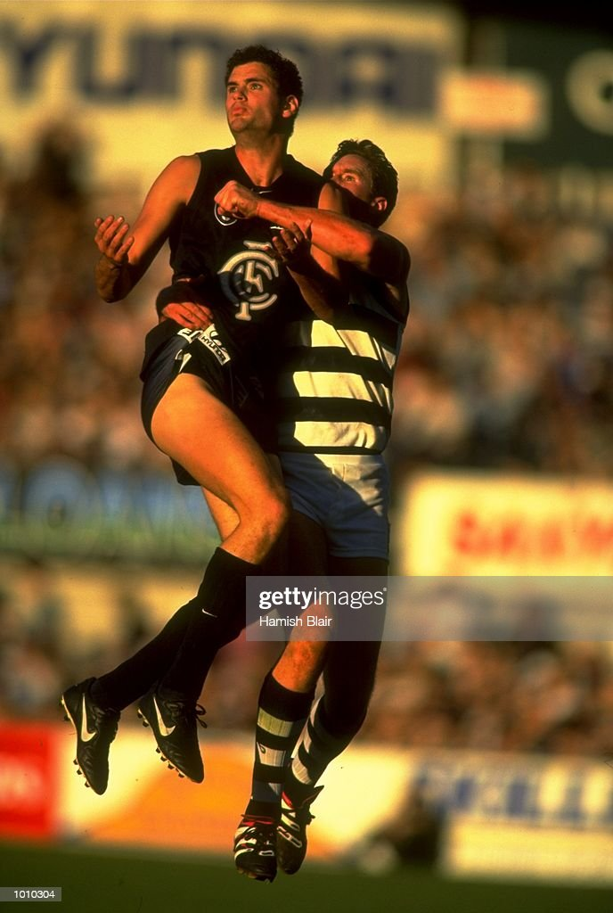 Tony Bourke of the Carlton Blues in a mid-air tussle with Geelong's Ben Graham, during the AFL Premiership Round 5 match at the Optus Oval, Melbourne, Australia. The Geelong Cats (115) defeated the Carlton Blues (65). \ Mandatory Credit: Hamish Blair /Allsport