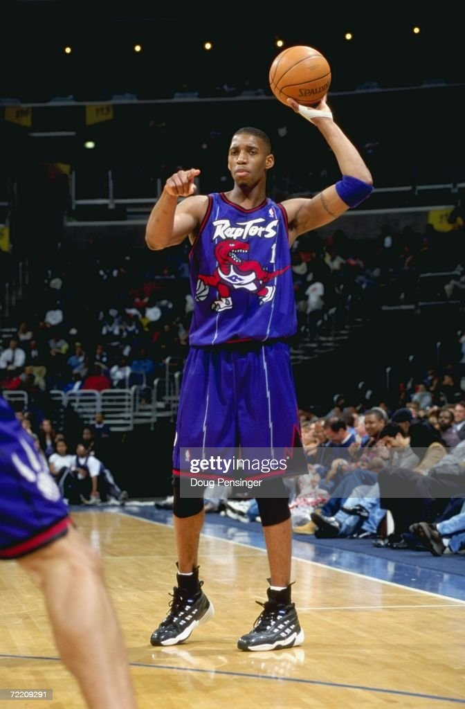 Tracy McGrady of the Toronto Raptors points as he's ready to pass the ball during the game against the Washington Wizards at the MCI Center in...