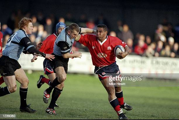 Salesi Finau of Llanelli hands off Cardiff's Lee Jarvis during the SWALEC Cup semifinal between Llanelli and Cardiff played at Bridgend Wales...