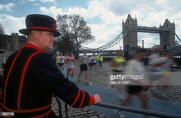 A Beefeater watches the action in the Flora London Marathon in London England Mandatory Credit Gary M Prior/Allsport