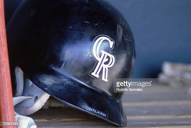 A view a Colorado Rockies helmet on the dugout bench taken during a game against the St Louis Cardinals at Coors Field in Denver Colorado The...