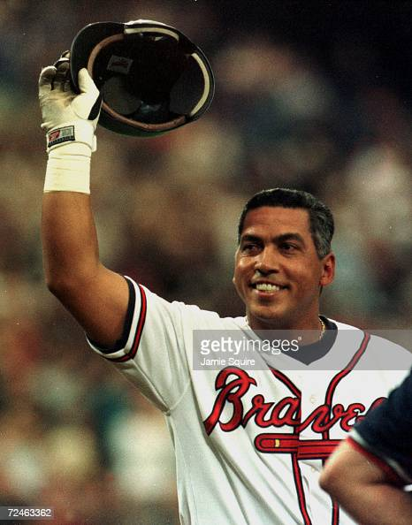 Andres Galarraga of the Atlanta Braves reacts after fans cheer his return from Cancer during Monday''s opening day game against the Colorado Rockies...