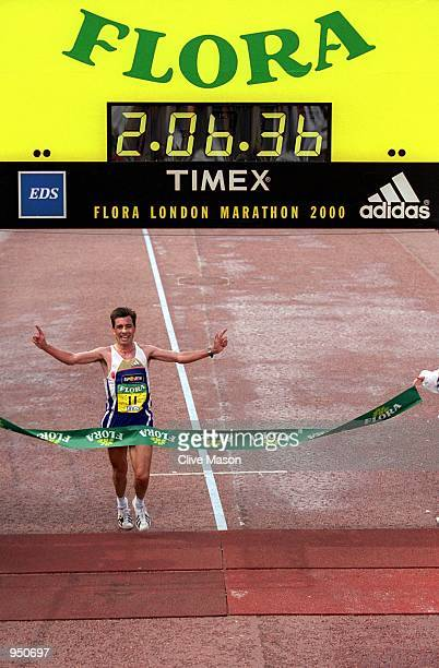 Antonio Pinto of Portugal takes the tape to win his third Flora London Marathon in London England Pinto set a new European and Course Record...