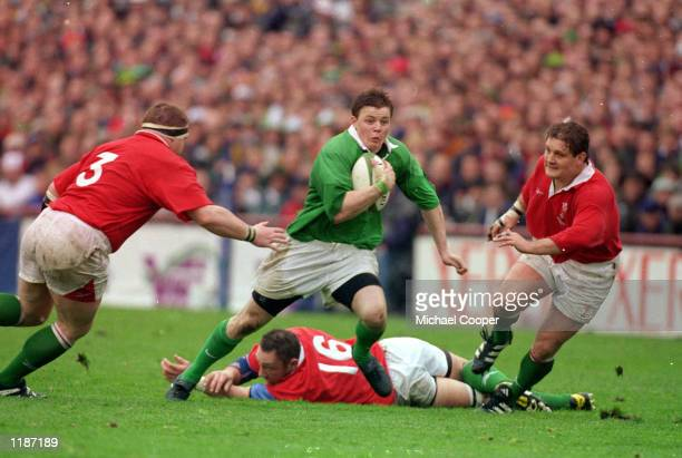 Brian O Driscoll of Ireland splits the Welsh defence during the Six Nations Championships game between Ireland and Wales at Lansdowne Road in Dublin...