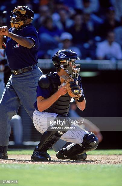 Catcher Brent Mayne of the Colorado Rockies squats behind the plate as he throws the ball during the game against the St Louis Cardinals at Coors...