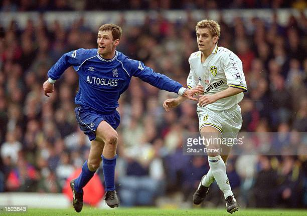 Chris Sutton of Chelsea tussles with Jonathan Woodgate of Leeds United during the FA Carling Premiership match at Elland Road in Leeds England...