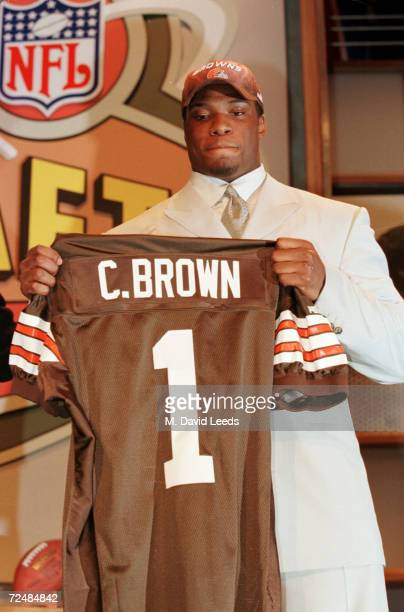 Courtney Brown holds up a Brown''s jersey after Cleveland made him the number one pick in the 2000 NFL Draft at the Paramount Theater at Madison...