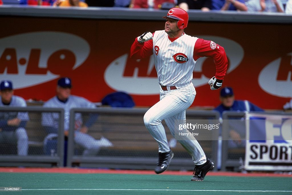 Dante Bichette #9 of the Cincinnati Reds runs to home plate during the game against the Los Angeles Dodgers at Cinergy Field in Cincinnati, Ohio. The Dodgers defeated the Reds 11-3. Mandatory Credit: Harry How /Allsport